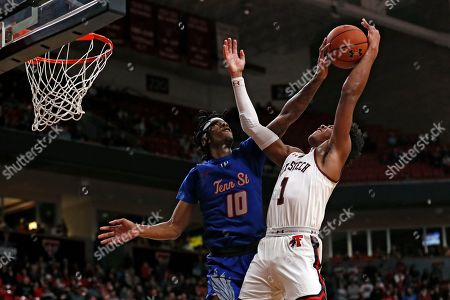 Tennessee State's Shakem Johnson (10) fouls Texas Tech's Terrence Shannon Jr. (1) as he shoots the ball during the second half of an NCAA college basketball game, in Lubbock, Texas