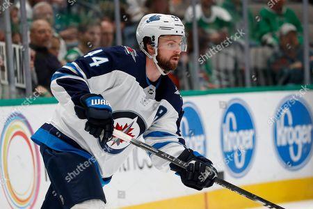 Winnipeg Jets defenseman Josh Morrissey (44) handles the puck during an NHL hockey game against the Dallas Stars in Dallas