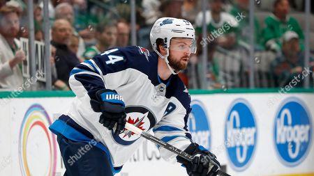 Winnipeg Jets defenseman Josh Morrissey (44) follows play during an NHL hockey game against the Dallas Stars in Dallas