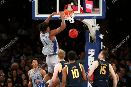 Stock Picture of Vernnon Carey Jr., Wendell Moore Jr., Kareem South, Grant Anticevich. Duke center Vernon Carey Jr. (1) dunks as forward Wendell Moore Jr. (0) and California guard Kareem South (10) and forward Grant Anticevich (15) watch during the second half of an NCAA college basketball game in the 2K Empire Classic, in New York. Duke won 87-52