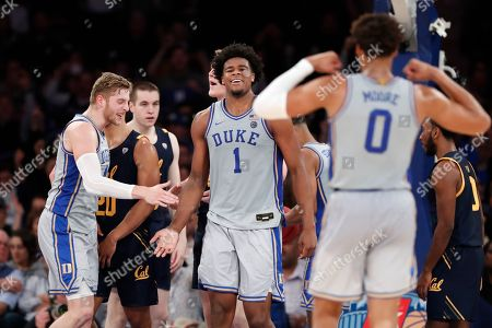 Stock Image of Alex O'Connell, Vernon Carey Jr., Wendell Moore Jr. Duke center Vernon Carey (1), who had dunked, in congratulated by teammates, including guard Alex O'Connell, left, and forward Wendell Moore Jr. (0), during the second half of an NCAA college basketball game against California in the 2K Empire Classic, in New York. Duke won 87-52