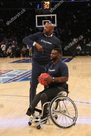 Basketball legend Alonzo Mourning gives props to Chris Saint-Remy from CUNY's Inclusive Sports basketball program, who bested him in a game of HORSE at the 2K Empire Classic at Madison Square Garden as part of Guardian Life's Equal & Able Partnership, in New York