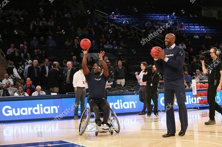 Basketball legend Alonzo Mourning partners with Guardian Life to showcase that disability is not inability during a game of HORSE with wheelchair basketball star Chris Saint-Remy of CUNY during the 2K Empire Classic at Madison Square Garden on in New York
