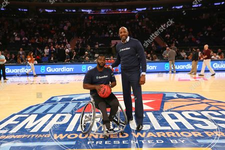 Stock Image of Basketball legend Alonzo Mourning partners with Guardian Life to showcase that disability is not inability during a game of HORSE with wheelchair basketball star Chris Saint-Remy of CUNY during the 2K Empire Classic at Madison Square Garden on in New York
