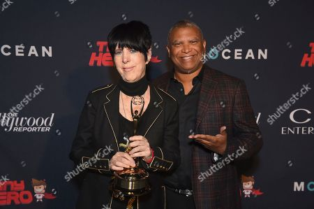 Reginald Hudlin, Diane Warren. Diane Warren, left, and Reginald Hudlin pose with a Clio award at the 2019 Clio Entertainment Awards, at the Dolby Theatre in Los Angeles