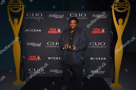 Craig Robinson poses with a Clio award at the 2019 Clio Entertainment Awards, at the Dolby Theatre in Los Angeles
