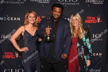 Craig Robinson, Ashley Falls, Nicole Purcell. Clio Entertainment Director, Ashley Falls, from left, Craig Robinson and Clio Entertainment President, Nicole Purcell, pose with a Clio award at the 2019 Clio Entertainment Awards, at the Dolby Theatre in Los Angeles