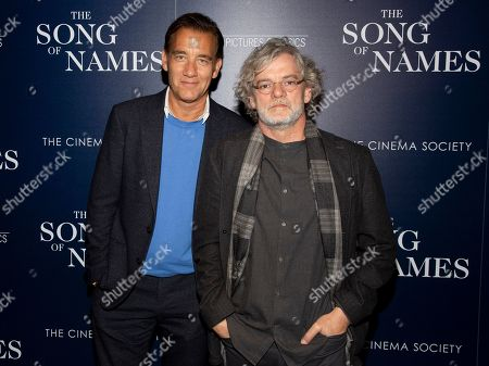"""Clive Owen, Francois Girard. Clive Owen, left, and Francois Girard, right, attend a special screening of """"The Song of Names,"""" hosted by Sony Pictures Classics and The Cinema Society, at Regal Essex Crossing, in New York"""