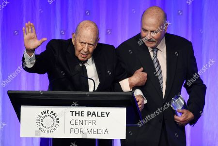 """Rob Reiner, Carl Reiner. Honoree Carl Reiner, left, waves to the audience as he is escorted offstage by his son Rob Reiner at """"The Paley Honors: A Special Tribute to Television's Comedy Legends"""" at the Beverly Wilshire Hotel, in Beverly Hills, Calif"""
