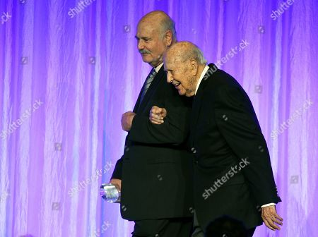 """Rob Reiner, Carl Reiner. Rob Reiner, left, escorts his father, honoree Carl Reiner, onstage at """"The Paley Honors: A Special Tribute to Television's Comedy Legends"""" at the Beverly Wilshire Hotel, in Beverly Hills, Calif"""