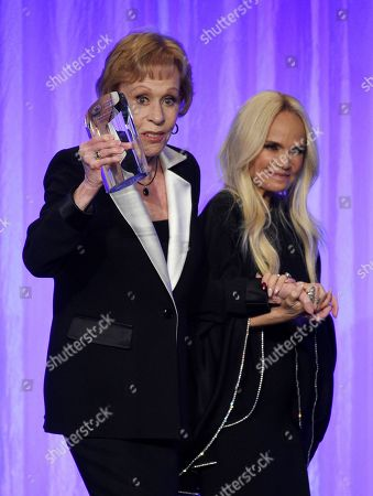 """Carol Burnett, Kristin Chenoweth. Honoree Carol Burnett, left, is led offstage by presenter Kristin Chenoweth during """"The Paley Honors: A Special Tribute to Television's Comedy Legends"""" at the Beverly Wilshire Hotel, in Beverly Hills, Calif"""