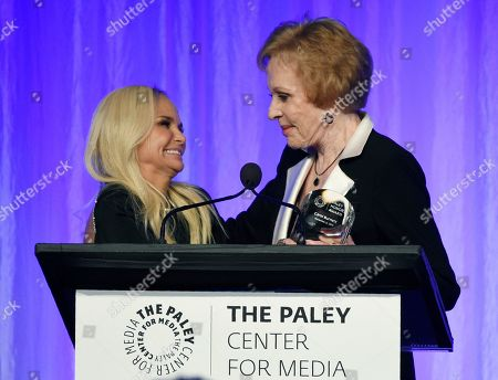 """Kristin Chenoweth, Carol Burnett. Presenter Kristin Chenoweth, left, presents honoree Carol Burnett with her award at """"The Paley Honors: A Special Tribute to Television's Comedy Legends"""" at the Beverly Wilshire Hotel, in Beverly Hills, Calif"""