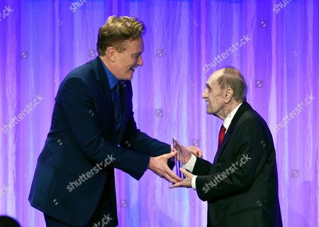 "Conan O'Brien, Bob Newhart. Honoree Bob Newhart, right, accepts his award from presenter Conan O'Brien during ""The Paley Honors: A Special Tribute to Television's Comedy Legends"" at the Beverly Wilshire Hotel, in Beverly Hills, Calif"
