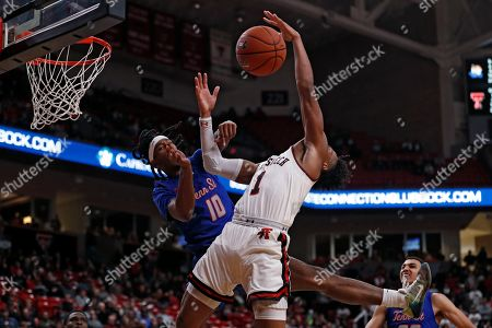 Shakem Johnson, Terrence Shannon Jr. Tennessee State's Shakem Johnson (10) fouls Texas Tech's Terrence Shannon Jr. (1) as he shoots the ball during the second half of an NCAA college basketball game, in Lubbock, Texas