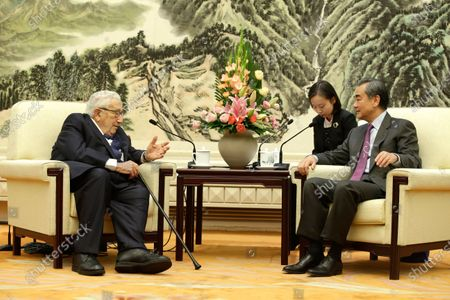 Chinese Foreign Minister Wang Yi (R) and former US Secretary of State Henry Kissinger (L) attend a meeting at the Great Hall of the People in Beijing, China, 22 November 2019.