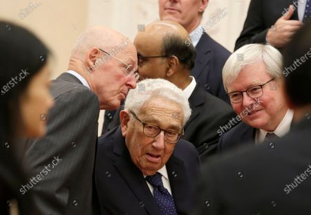 Members of a delegation from the 2019 New Economy Forum, former US Treasury Secretary Henry Paulson (L), former US Secretary of State Henry Kissinger (C) and former Australian Prime Minister Kevin Rudd (R), chat before a meeting with Chinese President Xi Jinping at the Great Hall of the People in Beijing, China, 22 November 2019.