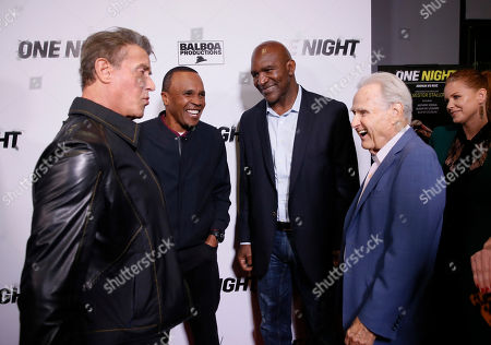 "Sylvester Stallone, Sugar Ray Leonard, Evander Holyfield, Larry Merchant, Carrie Keagan. From left to right, Executive Producer Sylvester Stallone, boxing legends Sugar Ray Leonard, Evander Holyfield, hall of fame boxing broadcaster Larry Merchant, and executive producer Carrie Keagan speak on the red carpet at the premiere of DAZN's ""ONE NIGHT: JOSHUA VS. RUIZ,"" a documentary film from Balboa Productions and DAZN Originals at the Writers Guild Theater, in Beverly Hills, Calif"