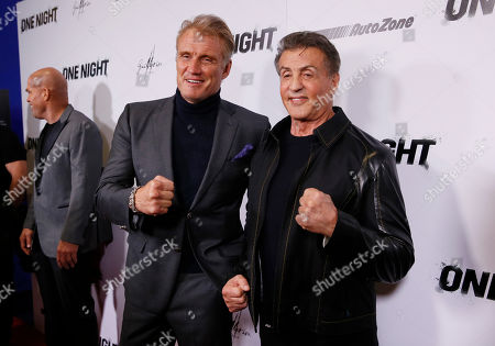 """Dolph Lundgren, Sylvester Stallone. Rocky"""" co-star Dolph Lundgren, left, poses with Executive Producer Sylvester Stallone, right, on the red carpet at the premiere of DAZN's """"ONE NIGHT: JOSHUA VS. RUIZ,"""" a documentary film from Balboa Productions and DAZN Originals at the Writers Guild Theater, in Beverly Hills, Calif"""