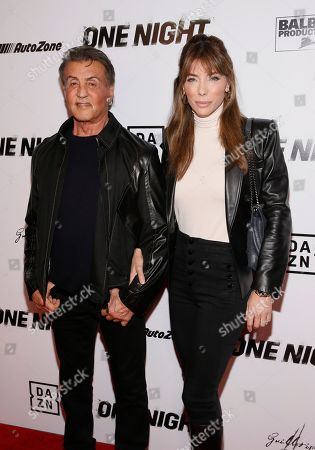 """Sylvester Stallone, Jennifer Flavin. Executive Producer Sylvester Stallone, left, and wife and entrepreneur Jennifer Flavin, right, pose on the red carpet at the premiere of DAZN's """"ONE NIGHT: JOSHUA VS. RUIZ,"""" a documentary film from Balboa Productions and DAZN Originals at the Writers Guild Theater, in Beverly Hills, Calif"""