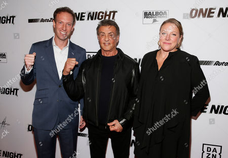 """Jamie Horowitz, Sylvester Stallone, Deirdre Fenton. DAZN Executive Vice President Jamie Horowitz, left, Executive Producer Sylvester Stallone, center, and Director Deirdre Fenton, right, pose on the red carpet at the premiere of DAZN's """"ONE NIGHT: JOSHUA VS. RUIZ,"""" a documentary film from Balboa Productions and DAZN Originals at the Writers Guild Theater, in Beverly Hills, Calif"""
