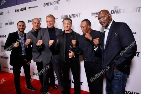 "Sergio Mora, Tito Ortiz, Dolph Lundgren, Sylvester Stallone, Sugar Ray Leonard, Evander Holyfield. From left to right, boxer Sergio Mora, MMA fighter Tito Ortiz, actor Dolph Lundgren, Executive Producer Sylvester Stallone, along with boxing legends Sugar Ray Leonard and Evander Holyfield pose on the red carpet at the premiere of DAZN's ""ONE NIGHT: JOSHUA VS. RUIZ,"" a documentary film from Balboa Productions and DAZN Originals at the Writers Guild Theater, in Beverly Hills, Calif"