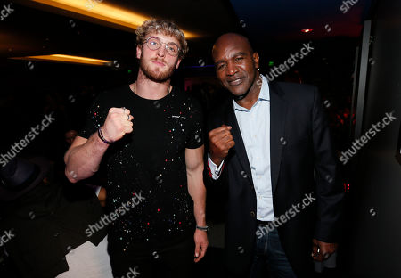 "Logan Paul, Evander Holyfield. Boxer and YouTube Star Logan Paul, left, and former heavyweight boxing champion Evander Holyfield pose during the after party at the premiere of DAZN's ""ONE NIGHT: JOSHUA VS. RUIZ,"" a documentary film from Balboa Productions and DAZN Originals at the Writers Guild Theater, in Beverly Hills, Calif"