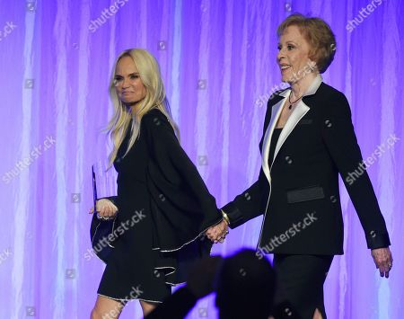 """Kristin Chenoweth, Carol Burnett. Presenter Kristin Chenoweth, left, escorts honoree Carol Burnett onstage at """"The Paley Honors: A Special Tribute to Television's Comedy Legends"""" at the Beverly Wilshire Hotel, in Beverly Hills, Calif"""