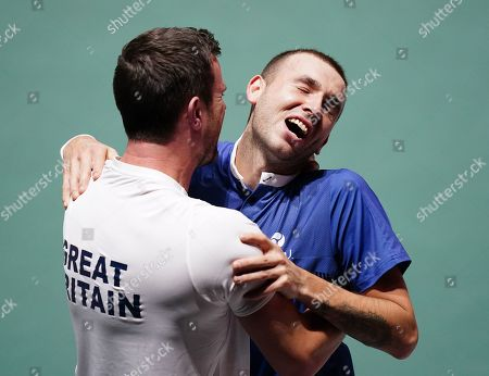 Great Britain's Dan Evans celebrates his win with captain Leon Smith in match against Germany