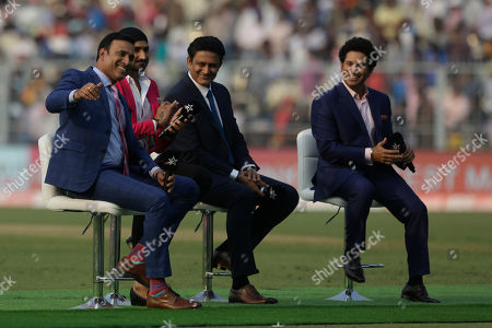 From right, India's former cricket players Sachin Tendulkar, Anil Kumble, Harbhajan Singh and V. V. S. Laxman join in a talk show during a break on the first day of the second test match between India and Bangladesh, in Kolkata, India
