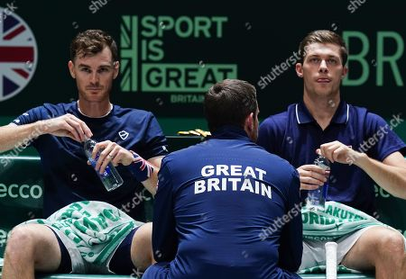 Stock Image of Great Britain's  captain Leon Smith talks to Jamie Murray and Neal Skupski during Doubles match against Spain