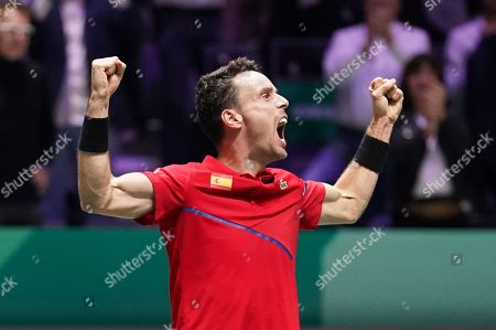 Spain's Roberto Bautista Agut celebrates as he wins the opening singles in the final against Canada