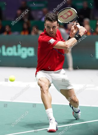 Spain's Roberto Bautista Agut  action  as he wins the opening singles in the final against Canada