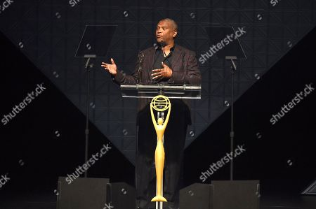 Reginald Hudlin, presents an award at the 2019 Clio Entertainment Awards, at the Dolby Theatre in Los Angeles