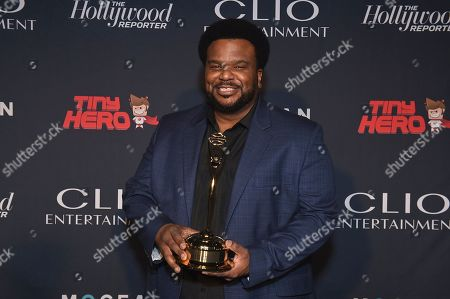 Host Craig Robinson poses with a Clio Entertainment Award at the 2019 Clio Entertainment Awards, at the Dolby Theatre in Los Angeles