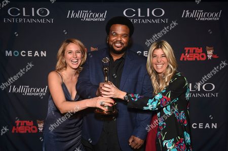 Craig Robinson, Ashley Falls, Nicole Purcell. From left, Clio Entertainment Director, Ashley Falls, host Craig Robinson and Clio Entertainment President, Nicole Purcell, pose at the 2019 Clio Entertainment Awards, at the Dolby Theatre in Los Angeles