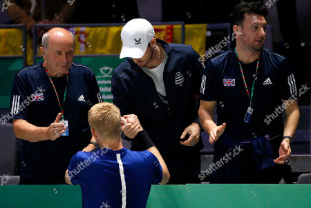 Kyle Edmund of Great Britain celebrates with Andy Murray versus Spain