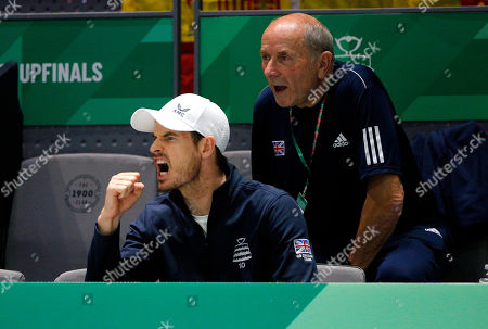 Kyle Edmund of Great Britain celebrates from the bench versus Spain