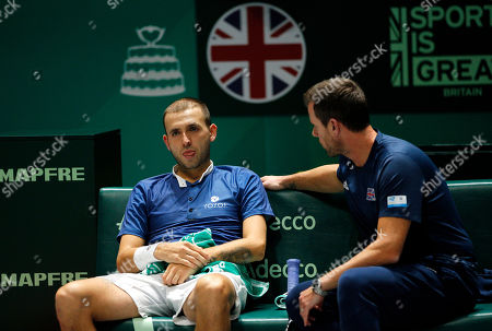 Stock Photo of Daniel Evans of Great Britain frustrated on the bench with Captain Leon Smith