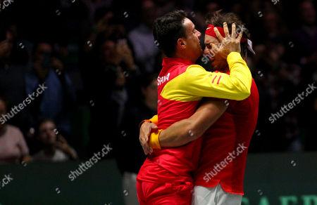 Rafael Nadal of Spain celebrates with Roberto Bautista Agut versus Canada