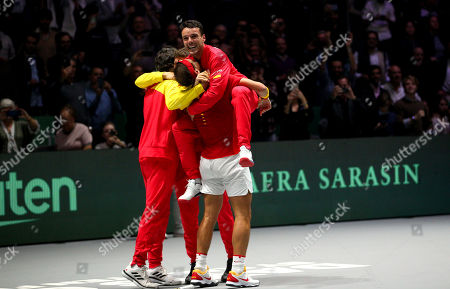 Stock Image of Rafael Nadal of Spain celebrates with Roberto Bautista Agut versus Canada