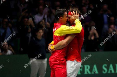 Rafael Nadal of Spain celebrates with team mate Roberto Bautista Agut versus Canada