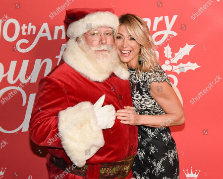Stock Photo of Debbie Matenopoulos and Santa Claus