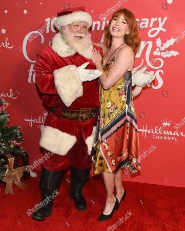 Stock Image of Alicia Witt and Santa Claus