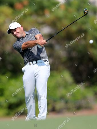 Francesco Molinari, of Italy, plays a shot on the 2nd hole during the second round of the DP World Tour Championship golf tournament in Dubai, United Arab Emirates