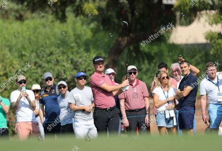 Justin Rose of England follows his ball on the 2nd hole during the second round of the DP World Tour Championship golf tournament in Dubai, United Arab Emirates