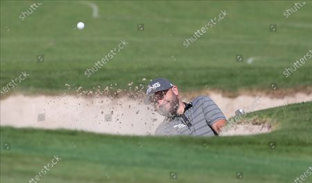 Stock Image of Andy Sullivan of England hits a shot from bunker during the second round of the DP World Tour Championship, European Tour, golf tournament 2019 at Jumeirah Golf Estates in Dubai, United Arab Emirates, 22 November 2019.