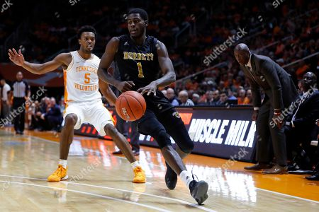 Stock Image of Alabama State guard Leon Daniels (1) dribbles an inbound pass as he's defended by Tennessee guard Josiah-Jordan James (5) during the first half of an NCAA college basketball game, in Knoxville, Tenn