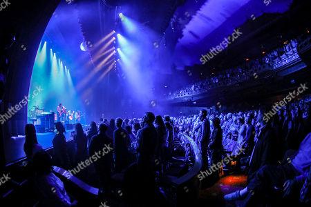 Stock Picture of Seth Avett, Scott Avett, Bob Crawford, Joe Kwon. Seth Avett, Scott Avett, Bob Crawford and Joe Kwon with The Avett Brothers perform at the Fox Theatre, in Atlanta