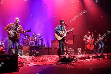 Seth Avett, Scott Avett, Bob Crawford, Joe Kwon. Seth Avett, Scott Avett, Bob Crawford and Joe Kwon with The Avett Brothers perform at the Fox Theatre, in Atlanta