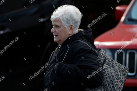 Stock Photo of The wife of former Penn State University assistant football coach Jerry Sandusky, Dottie Sandusky, leaves the Centre County Courthouse after attending a resentencing hearing on his 45-count child sexual abuse conviction